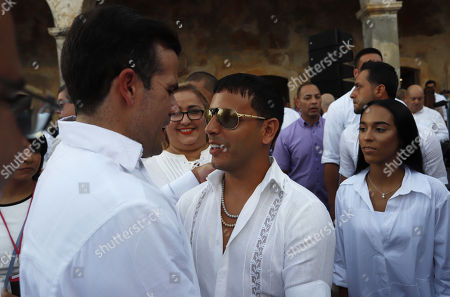 The governor of Puerto Rico Ricardo Rossello (L) converses with singer Tito el Bambino (C) during an event to remember victims of Hurricane Maria at the Castillo San Cristobal in Old San Juan, Puerto Rico, 20 September 2018. The governor of Puerto Rico, Ricardo Rossello, said no one was prepared to face a devastating hurricane like Maria, which one year ago, razed the Caribbean island. Official figures of the hurrican put the number of dead at 2,975, in Puerto Rico.