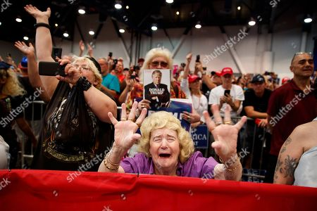 Supporters of President Donald Trump cheer as he speaks during a campaign rally, in Las Vegas