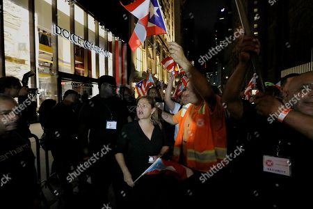 Former head of the New York City Council Melissa Mark-Viverito (C) joins hundreds of people in protest near Trump Tower after a bilingual interfaith memorial service for victims of Hurricane Maria, at St. Bartholomew's Church in New York, New York, USA, 20 September 2018. Over 3,000 people lost their lives and thousands more have been displaced from the island of Puerto Rico by Hurricane Maria.