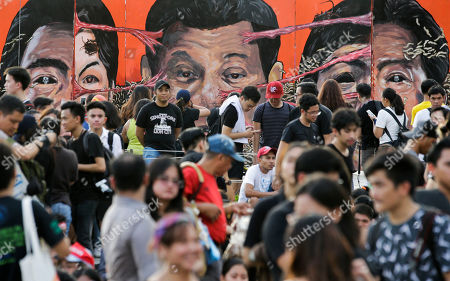 """Caricatures from left; House Speaker Gloria Macapagal Arroyo, Philippine President Rodrigo Duterte, and former Senator Ferdinand """"Bongbong"""" Marcos Jr. are on display during a rally to call for an end to the killings in the so-called war on drugs of Duterte as well as his alleged """"tyrannical rule"""" of the country, in Manila, Philippines. Protesters are marking the anniversary of the 1972 martial law declaration by the late Philippine dictator Ferdinand Marcos with an outcry against what they say is the current president's authoritarian tendencies and his brutal crackdown on illegal drugs"""