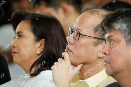 Former Philippine President Benigno Aquino III (C) gestures as Philippine Vice-President Leni Robredo (L) looks on during a mass to mark the 46th anniversary of the declaration of Martial Law at a school in Manila, Philippines, 21 September 2018. Human rights groups and government organizations staged protest rallies in different parts of the country marking the 46th anniversary of the declaration of martial law. Former strongman Ferdinand Marcos imposed martial law for nine years from September 1972, during which thousands of people, most of them accused of being enemies of the state, were arrested, tortured, killed and disappeared.