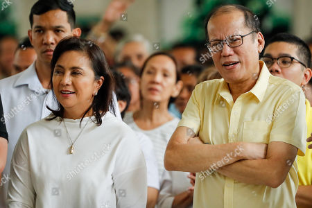 Philippine Vice-President Leni Robredo (L) and former Philippine President Benigno Aquino III (R) attend a mass to mark the 46th anniversary of the declaration of Martial Law at a school in Manila, Philippines, 21 September 2018. Human rights groups and government organizations staged protest rallies in different parts of the country marking the 46th anniversary of the declaration of martial law. Former strongman Ferdinand Marcos imposed martial law for nine years from September 1972, during which thousands of people, most of them accused of being enemies of the state, were arrested, tortured, killed and disappeared.