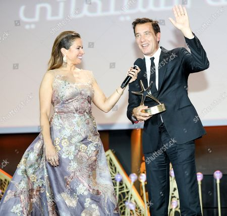 British Actor Clive Owen reacts as Lebanese presenter Raya Abirached looks on during the opening ceremony of Gouna Film Festival at El Gouna, 470km southeast of Cairo, Egypt, 20 September 2018 (Issued 21 September 2018). The second edition of El Gouna Film Festival will be held between 20 to 28 September 2018 at the red sea city of El Gouna, 470km southeast of Cairo.