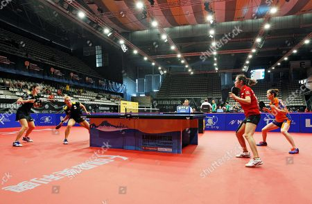 Stock Image of Spain's Galia Dvorak (2-L) and Maria Xiao (L) compete against Li Jie (R) of the Netherlands  and Li Qian (2-R) of Poland during their women's doubles game at the 2018 ITTF European Table Tennis Championships in Alicante, Spain, 21 September 2018.
