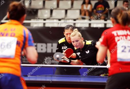 Stock Photo of Spain's Galia Dvorak (C-R) and Maria Xiao (C-L) compete against Li Jie (L) of the Netherlands  and Li Qian (R) of Poland during their women's doubles game at the 2018 ITTF European Table Tennis Championships in Alicante, Spain, 21 September 2018.