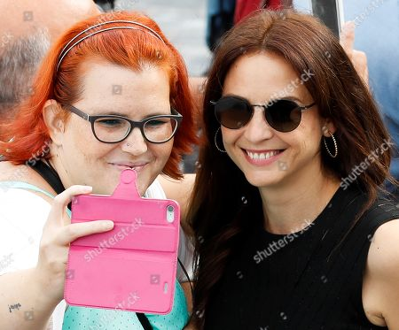 Spanish actress and cast member Leonor Watling (R) poses for a selfie with a fan during the presentation of 'Vivir sin permiso' (lit.: Living without permission) at the San Sebastian International Film Festival, in San Sebastian, Basque Country, Spain, 21 September 2018. The 66th edition of the SSIFF runs from 21 to 29 September.