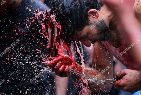 An Indian Shiite Muslim performs a ritual of self-flagellation with clusters of knives during a religious procession on the day Ashura, in New Delhi, India, 21 September 2018. During the first ten days of Muharram, the first month of the Islamic calendar, Shiite Muslims mourn in remembrance of the martyrdom of the Imam Hussain, the grandson of Prophet Mohammad, killed in a battle in 680 AD.