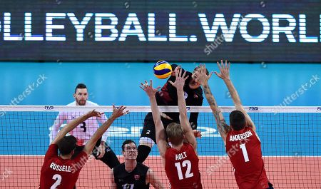 John Gordon Perrin (back) of Canada in action against Aaron Russell (L), Maxwell Holt (C) and Matthew  Anderson (R) of USA during 2018 FIVB Volleyball Men's World Championship Pool G match between USA and Canada in Sofia, Bulgaria on 21 September 2018.