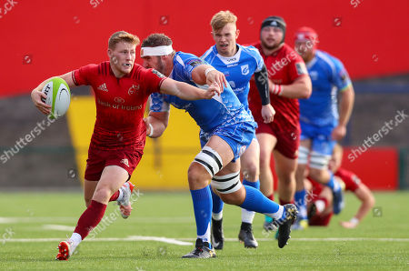 Munster vs Dragons. Munster?s John Poland is tackled by James Thomas of Dragons