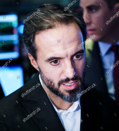 Jose Neves, the CEO of Farfetch, an online fashion house, talks with specialists during the company's IPO at the New York Stock Exchange in New York, New York, USA, on 21 September 2018.