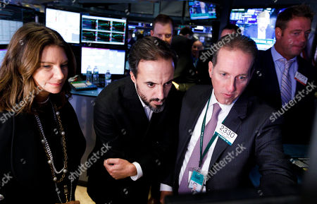 Jose Neves (C), the CEO of Farfetch, an online fashion house, talks with specialists during the company's IPO at the New York Stock Exchange in New York, New York, USA, on 21 September 2018.