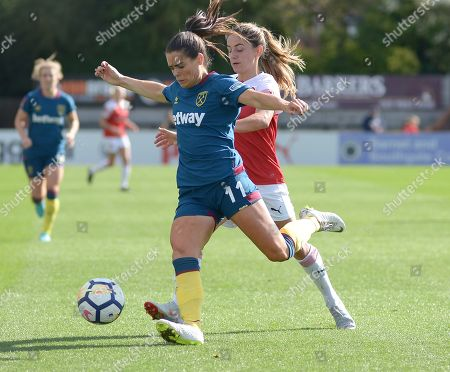 Claire Rafferty of West Ham Ladies clears the ball