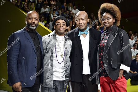 (L-R) US artist Theaster Gates, US director Spike Lee, Nigerian art critic and curator Okwui Enwezor and US director Dee Rees attend the inauguration of Prada Foundation's new film season in Milan, Italy, 21 September 2018. The Spring-Summer 2019 Women's collections are presented at the Milano Moda Donna from 19 to 24 September.