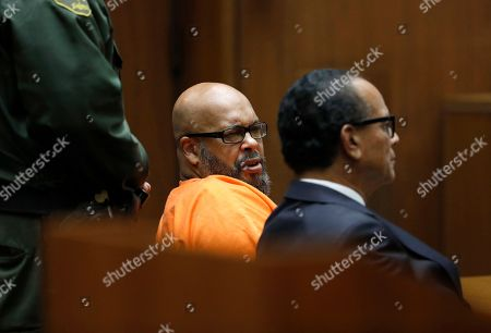 "Marion ""Suge"" Knight, left, with attorney Albert DeBlanc, pleads no contest to voluntary manslaughter in Los Angeles Superior Court on . The plea deal calls for Knight, 53, to serve 28 years in state prison"