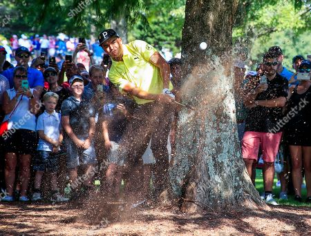 Rickie Fowler of the US hits from beside a tree on the tenth hole during the second round of the Tour Championship golf tournament and the FedEx Cup final at Eastlake Golf Club in Atlanta, Georgia, USA, 21 September 2018. Tournament play runs from 20 September to 23 September.