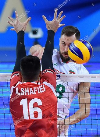 Stock Picture of Nikolay Nikolov (R) of Bulgaria in action against Ali Shafiei (L) of Iran during 2018 FIVB Volleyball Men's World Championship Pool G match between Bulgaria and Iran in Sofia, Bulgaria on 21 September 2018.