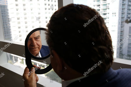 "Mario Kreutzberger, also known as Don Francisco, looks into a mirror as he appears during an interview, in the Brickell neighborhood of Miami. Kreutzberger is a well-known television personality with a TV show called ""Don Francisco Te Invita"