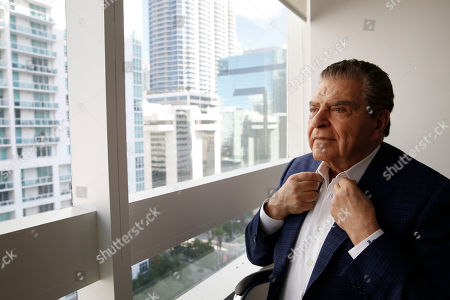 "Mario Kreutzberger, also known as Don Francisco, adjusts his collar as he appears during an interview, in the Brickell neighborhood of Miami. Kreutzberger is a well-known television personality with a TV show called ""Don Francisco Te Invita"