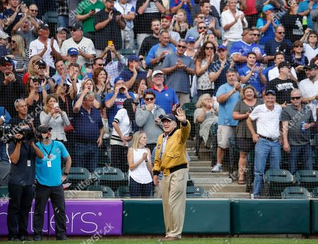 Stock Image of Capt. James A. Lovell, Jr., a former NASA astronaut and Naval Aviator, is honored during the third inning of a baseball game between the Chicago White Sox and Chicago Cubs, in Chicago