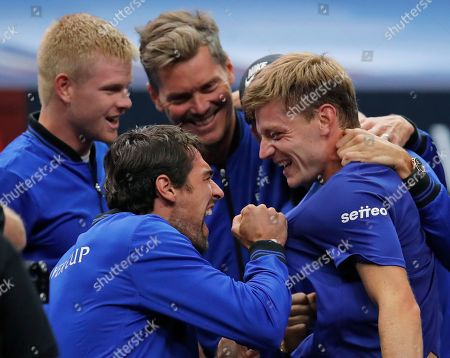 Stock Image of Team Europe's David Goffin, right, celebrates winning his tennis match against Team World's Diego Schwartzman with teammates Jeremy Chardy, second from left, Kyle Edmund, left, and Thomas Enqvist at the Laver Cup, in Chicago