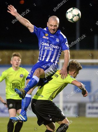 Stock Photo of Newry City vs Warrenpoint Town. Newry's Mark Hughes in action with Warrenpoints Marc Griffin