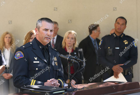 Stock Photo of Aaron Johnson, Anne Marie Schubert, Daniel Hahn. Commander Aaron Johnson, of the Rohnert Park Police Department, left, discusses the arrest of Roy Charles Waller, who is suspected of committing a series of rapes, during a news conference, in Sacramento, Calif. Waller, 58, was arrested on Thursday, Sept. 20, by Sacramento Police, and is suspected of committing at least 10 rapes across Northern California between 1991 and 2006. In the background is Sacramento County District Attorney Anne Marie Schubert, center, Sacramento Police Chief Daniel Hahn, right