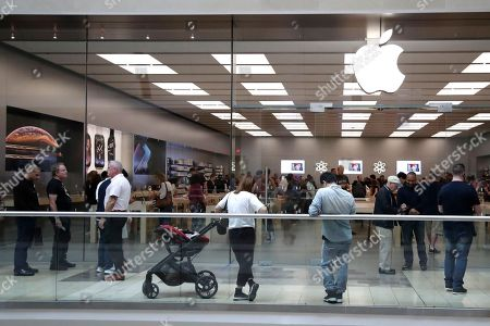 customers wait in line outside of the apple store at the garden state plaza on the - Apple Store Garden State Plaza