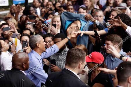 President Barack Obama meets with members of the audience as he campaigns in support of Pennsylvania candidates in Philadelphia