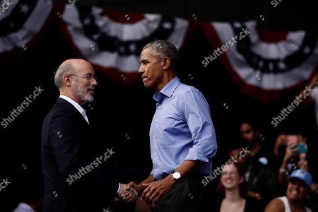 Former President Barack Obama, right, shakes hands with Gov. Tom Wolf, as he campaigns in support of Pennsylvania candidates in Philadelphia