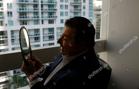 "Mario Kreutzberger, also known as Don Francisco looks into a mirror after he speaks during an Associated Press interview, in the Brickell neighborhood of Miami. Kreutzberger is a well-known television personality for the show ""Don Francisco Te Invita"
