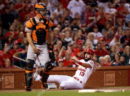 St. Louis Cardinals' Matt Carpenter (13) scores past San Francisco Giants catcher Nick Hundley during the first inning of a baseball game, in St. Louis