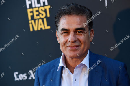 "Houshang Touzie, a cast member in ""Simple Wedding,"" poses at the premiere of the film at the 2018 Los Angeles Film Festival, in Culver City, Calif"