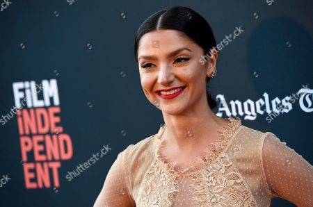 """Tara Grammy, a cast member in """"Simple Wedding,"""" poses at the premiere of the film at the 2018 Los Angeles Film Festival, in Culver City, Calif"""