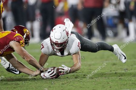 Kyle Sweet, Isaac Franco. Washington State wide receiver Kyle Sweet, right, recovers his own fumble next to Southern California linebacker Isaac Franco during the first half of an NCAA college football game, in Los Angeles