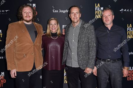 "Ben York Jones, Ruta Sepetys, Marius A. Markevicius, Zilvinas Naujoka. Ben York Jones, from left, Ruta Sepetys, Marius A. Markevicius and Zilvinas Naujoka attend the world premiere of ""Ashes in the Snow"" at the LA Film Festival, in Culver City, Calif"