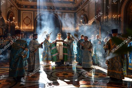 Stock Image of On, Russian Orthodox Church Patriarch Kirill, center, welcomes relics of the Saint Spyridon, Bishop of Trimythous from Corfu, Greece, during a service at the Christ the Savior Cathedral in Moscow, Russia