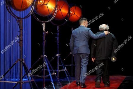US actor and film director Danny DeVito (R) receives the 'Donostia Award' in tribute to his film career from Spanish film maker Juan Antonio Bayona (L) during the 66th edition of San Sebastian international Film Festival (SSIFF), in San Sebastian, Basque Country, northern Spain, 22 September 2018. The SSIFF will be held from 21 to 29 September 2018.
