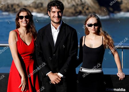 French director and actor Louis Garrel (C) poses with actresses and cast members Lily-Rose Melody Depp (R) and Laetitia Casta during the presentation of 'L'Homme Fidele' (A Faithful Man) at  the San Sebastian International Film Festival, in San Sebastian, Basque Country, Spain, 22 September 2018. The 66th edition of the SSIFF runs from 21 to 29 September.