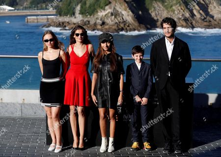 Stock Photo of French director and actor Louis Garrel (R) poses with cast members Lily-Rose Melody Depp (L), Laetitia Casta (2-L), and others (no names available) during the presentation of 'L'Homme Fidele' (A Faithful Man) at  the San Sebastian International Film Festival, in San Sebastian, Basque Country, Spain, 22 September 2018. The 66th edition of the SSIFF runs from 21 to 29 September.