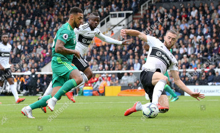 Calum Chambers of Fulham slides in to tackle