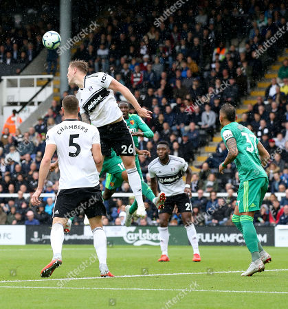 Alfie Mawson of Fulham heads clear watched by Calum Chambers of Fulham (5)