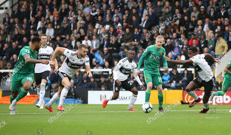 Will Hughes of Watford (19) slips a perfect ball to Andre Gray of Watford (L) finding Calum Chambers of Fulham (3rd L) out of position - Gray scores the opening goal inside 3 minutes