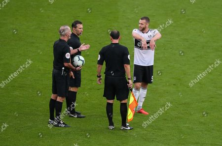 Calum Chambers of Fulham complains to referee about pushing