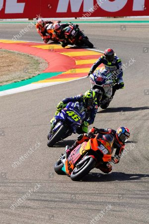 British MotoGP rider Bradley Smith (front) of the Red Bull KTM Factory Racing team and Italian rider Valentino Rossi (C) of the Movistar Yamaha MotoGP team in action during the free practice session at the MotorLand Aragon circuit in Alcaniz, northeastern Spain, 22 September 2018. The Motorcycling Grand Prix of Aragon will take place on 23 September 2018.