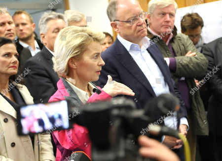 The German Minister of Defence, Ursula von der Leyen (2-R), and the State Governor of Lower Saxony, Stephan Weil (3-R) listen to the military leader of the firefighting deployment, Col. Thomas Groeters (not shown) at the military test site at the Wehrtechnische Dienststelle 91 (WTD 91) of the German Armed Forces (Bundeswehr) near Meppen, northern Germany, 22 September 2018. Hundreds of fire fighters and rescue workers struggle against a  massive moor fire which has extended to several square kilometers since a missile test went wrong more than two weeks ago. The Landkreis Emsland district has given disaster alert as several villages nearby are threatened by the smoke.