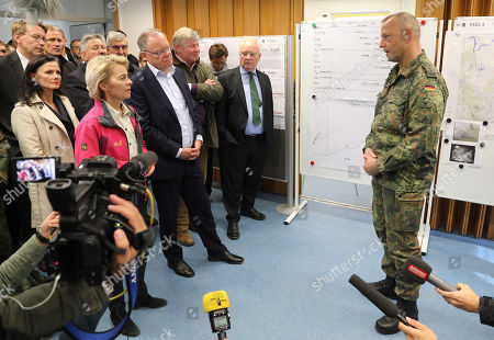 The German Minister of Defence, Ursula von der Leyen (2-R), and the State Governor of Lower Saxony, Stephan Weil (3-R) listen to the military leader of the firefighting deployment, Col. Thomas Groeters (R) at the military test site at the Wehrtechnische Dienststelle 91 (WTD 91) of the German Armed Forces (Bundeswehr) near Meppen, northern Germany, 22 September 2018. Hundreds of fire fighters and rescue workers struggle against a  massive moor fire which has extended to several square kilometers since a missile test went wrong more than two weeks ago. The Landkreis Emsland district has given disaster alert as several villages nearby are threatened by the smoke.