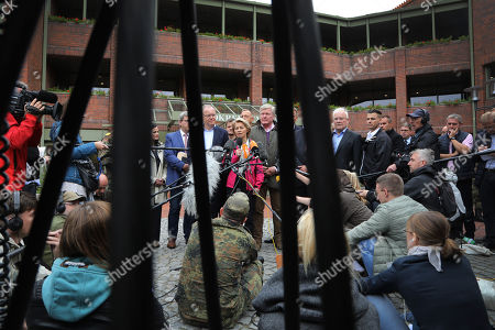(Center L-R) State Governor of Lower Saxony, Stephan Weil, German Minister of Defence, Ursula von der Leyen, and the Minister of Economy of Lower Saxony, Bernd Althusmann during a press statement after a visit at the military test site of the Wehrtechnische Dienststelle 91 (WTD 91) of the German Armed Forces (Bundeswehr) near Meppen, northern Germany, 22 September 2018. Hundreds of fire fighters and rescue workers struggle against a  massive moor fire which has extended to several square kilometers since a missile test went wrong more than two weeks ago. The Landkreis Emsland district has given disaster alert as several villages nearby are threatened by the smoke.