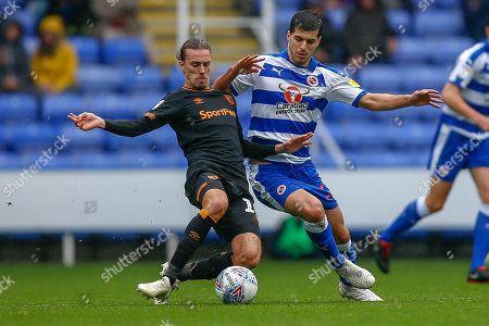 Reading midfielder Saeid Ezatolahi  (32) battle with Hull City midfielder Jackson Irvine (16) during the EFL Sky Bet Championship match between Reading and Hull City at the Madejski Stadium, Reading
