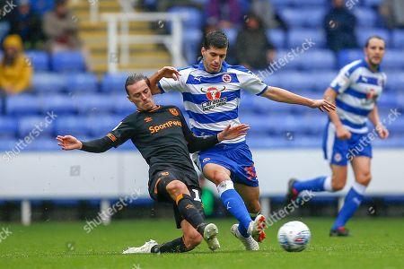 Hull City midfielder Jackson Irvine (16) tackles Reading midfielder Saeid Ezatolahi   (32)  during the EFL Sky Bet Championship match between Reading and Hull City at the Madejski Stadium, Reading