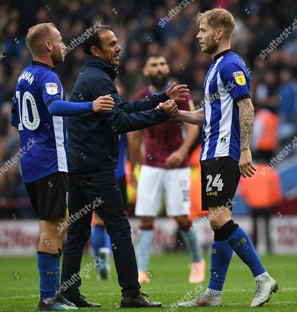 Jos Luhukay manager of Sheffield Wednesday congratulates Ashley Baker at full time
